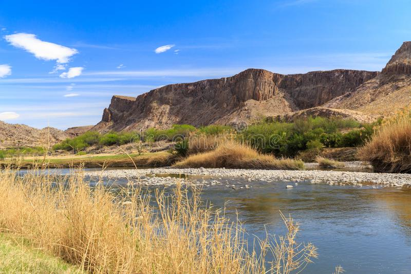 The Texas Mexico Border River and Hills. The Rio Grande River on the Texas Mexico Border by Big Bend National Park and Big Bend Ranch State park royalty free stock images