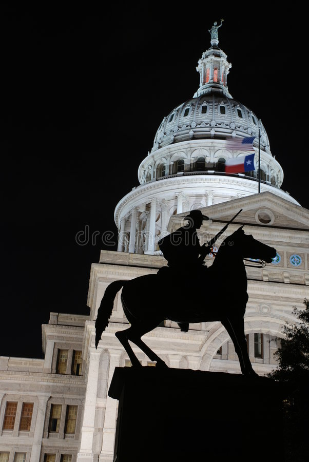 Texas Ranger Capitol Building. A statue of a war hero riding a horse in front of the Texas State Capitol Building in Austin, TX royalty free stock photography
