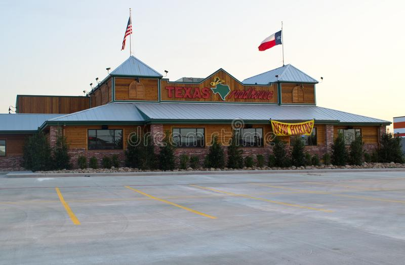 Texas Roadhouse restaurant in Humble, Texas. Houston, Texas/USA 09/06/2019: Texas Roadhouse restaurant being prepped for opening in Humble, TX with a hiring stock photos