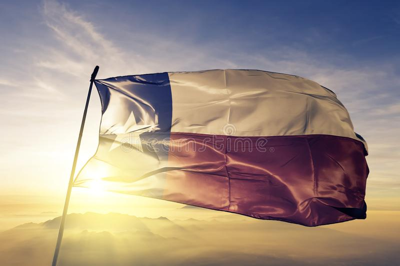 Texas state of the United States of America flag textile cloth fabric waving on the top. Texas flag textile cloth fabric waving on the top sunrise mist fog vector illustration