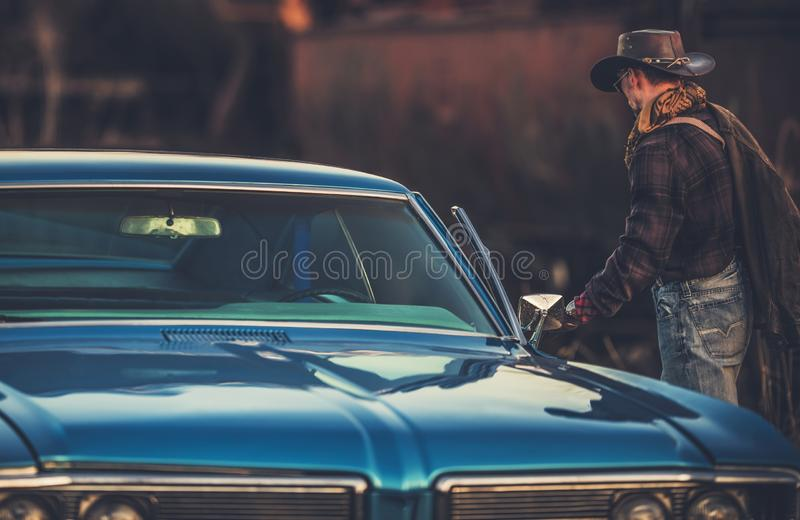 Texas Style Car Ride. Caucasian Western Style Wearing Cowboy and His Classic Car royalty free stock photos