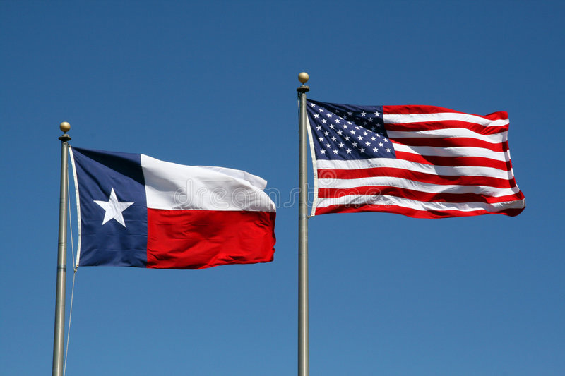 Texas and US Flag. A Texas and US flag boldly flapping in the wind stock images