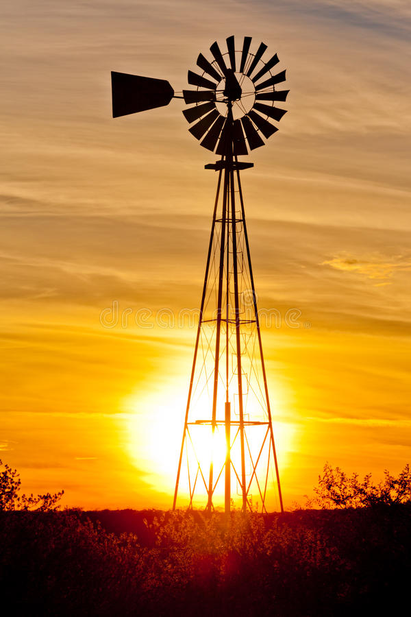 Texas wind pump sunset royalty free stock image