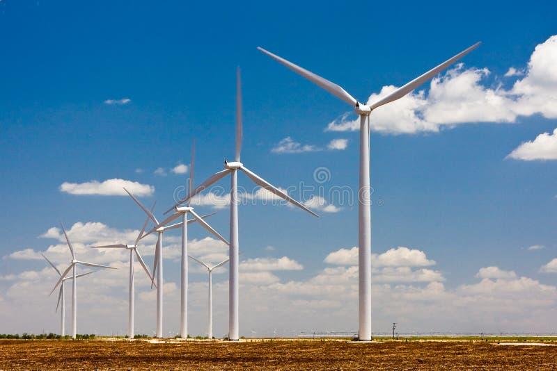Texas wind turbines. Wind turbines in a row against prairie sky stock photos