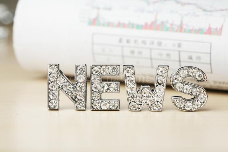 Text of 'news' with newspaper royalty free stock image