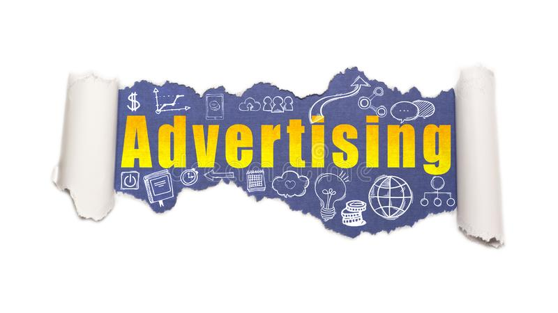 The text advertising behind torn white paper royalty free stock photo