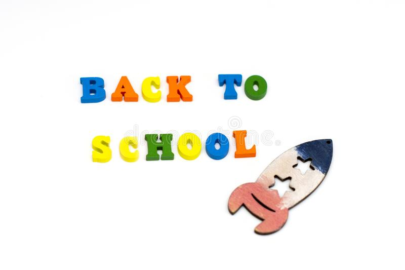 Text Back to school in colored wooden letters on white background. Text Back to school in colored wooden letters on white background royalty free stock photos