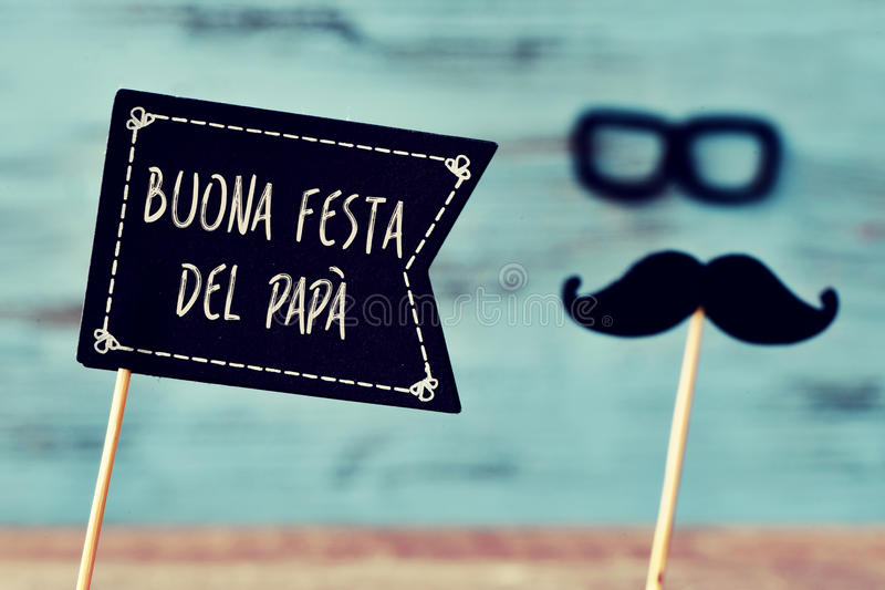 Text buona festa del papa, happy fathers day in italian. A black flag-shaped signboard with the text buona festa del papa, happy fathers day in italian, and a royalty free stock images
