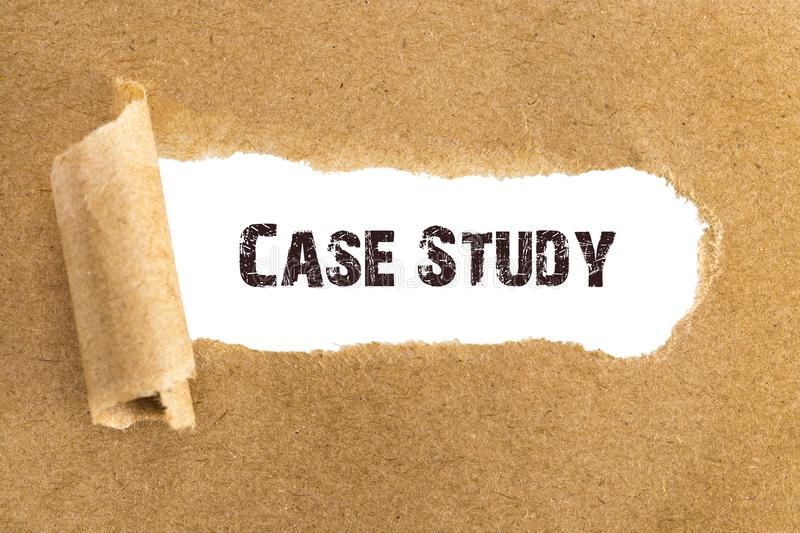 The text Case Study appearing behind torn brown paper royalty free stock photography
