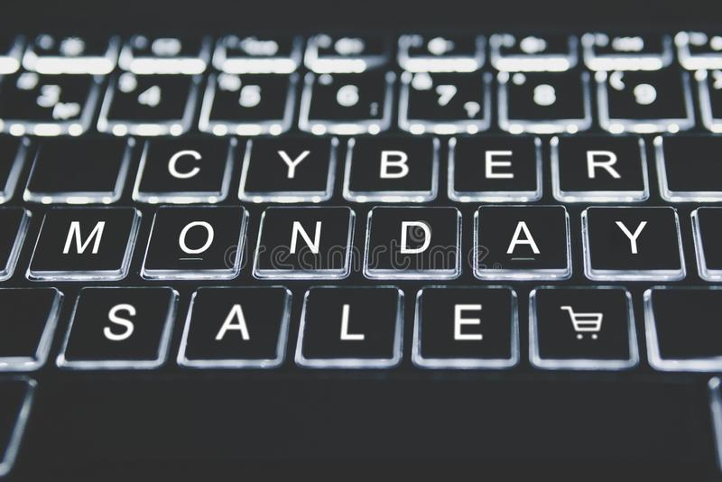 Text cyber Monday on your keyboard in the dark. The concept of online sales on day following black Friday. online shopping royalty free stock images