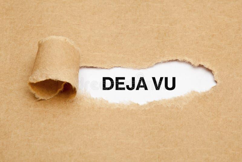 Deja Vu Ripped Paper Concept. Text Deja Vu appearing behind torn brown paper royalty free stock photo