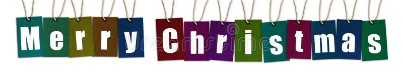 Text der frohen Weihnachten auf den multi Farbumbauten lokalisiert auf weißem Backg stockbild