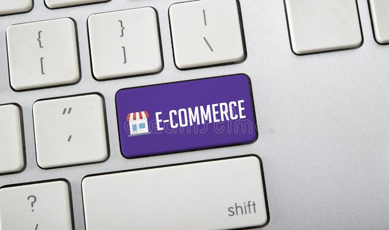 E-Commerce word on computer keyboard, online shopping concept stock photo
