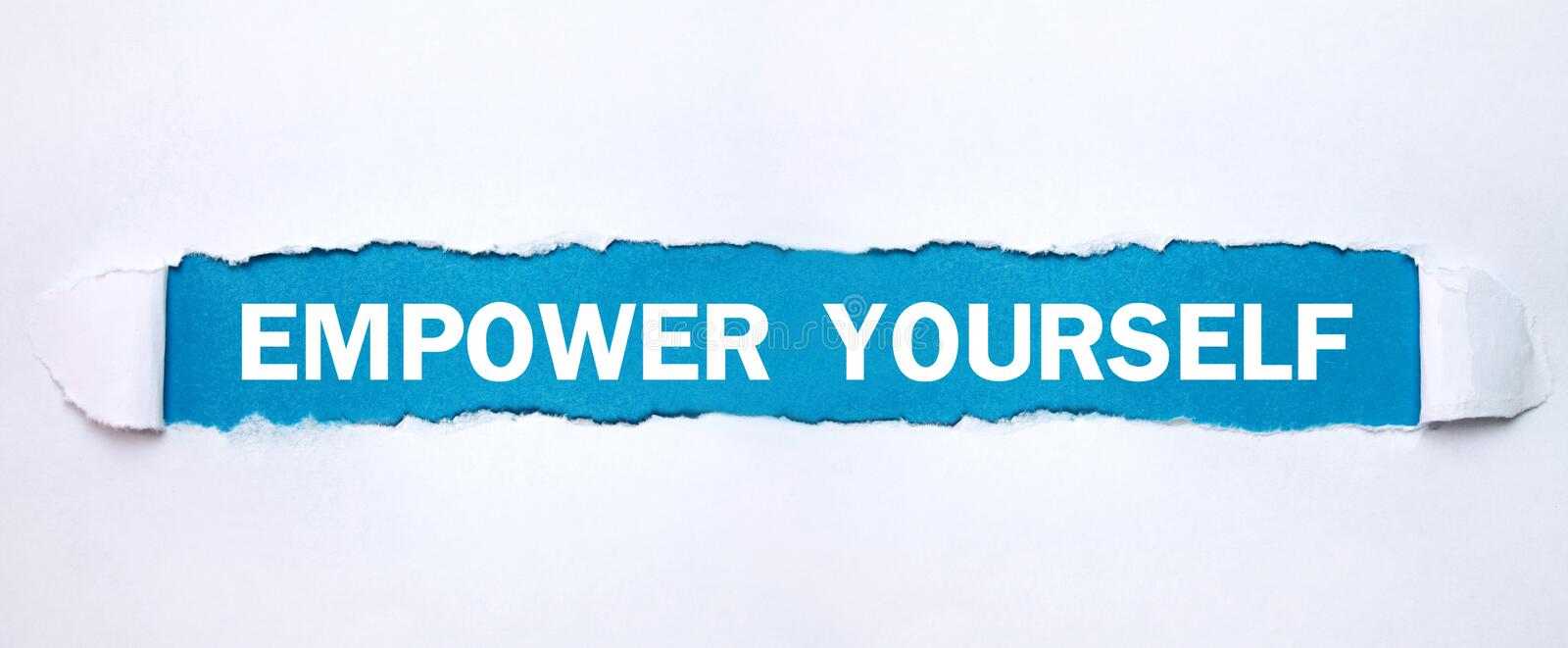 Text Empower Yourself on torn paper royalty free stock image