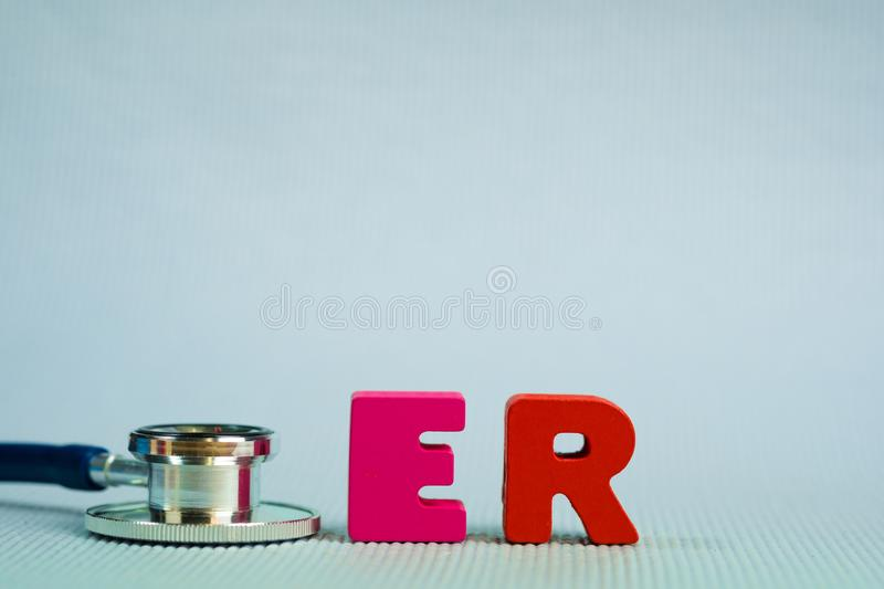 Text ER or emergency room alphabet with stethoscope, healthy and stock photography
