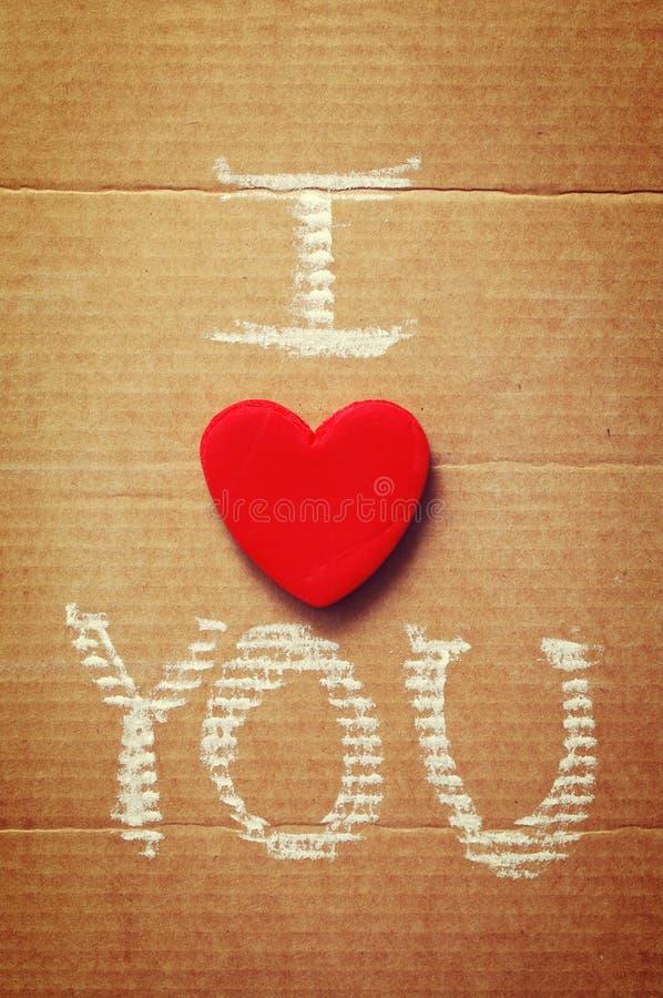 Text eu te amo, escrito no giz no papel fotografia de stock royalty free