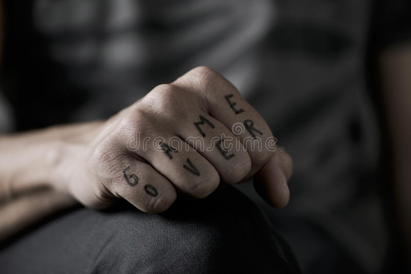 Text game over in the knuckles of a young man royalty free stock photo