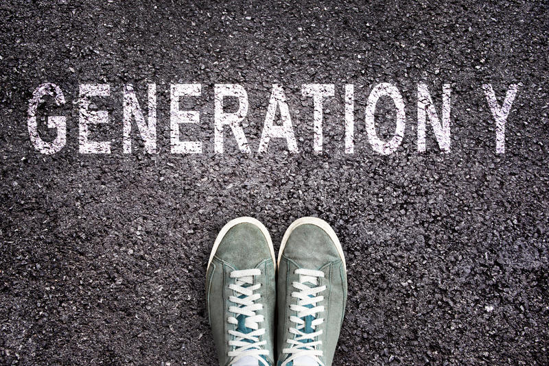 Text Generation Y written on asphalt with shoes. Text Generation Y written on asphalt floor with shoes royalty free stock photography