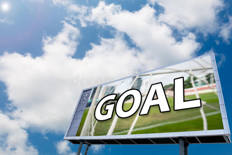 Text GOAL on led scoreboard , blue sky background royalty free stock images