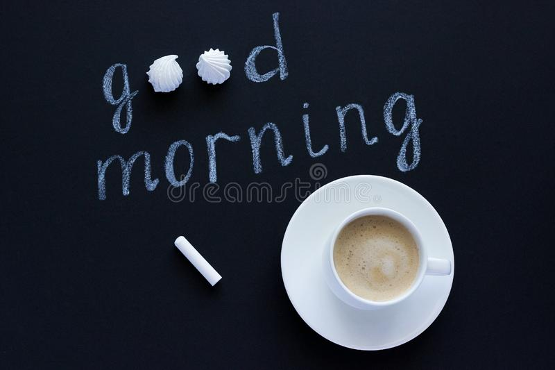 Text Good morning with chalk on black background cup coffee and. Text Good morning with chalk on black background, cup of coffee meringue. Flat Lay, Top View stock image