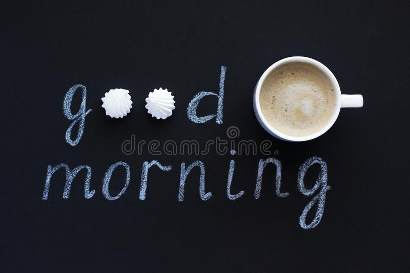 Text Good morning with chalk on black background cup coffee and. Text Good morning with chalk on black background, cup of coffee meringue. Flat Lay, Top View royalty free stock images