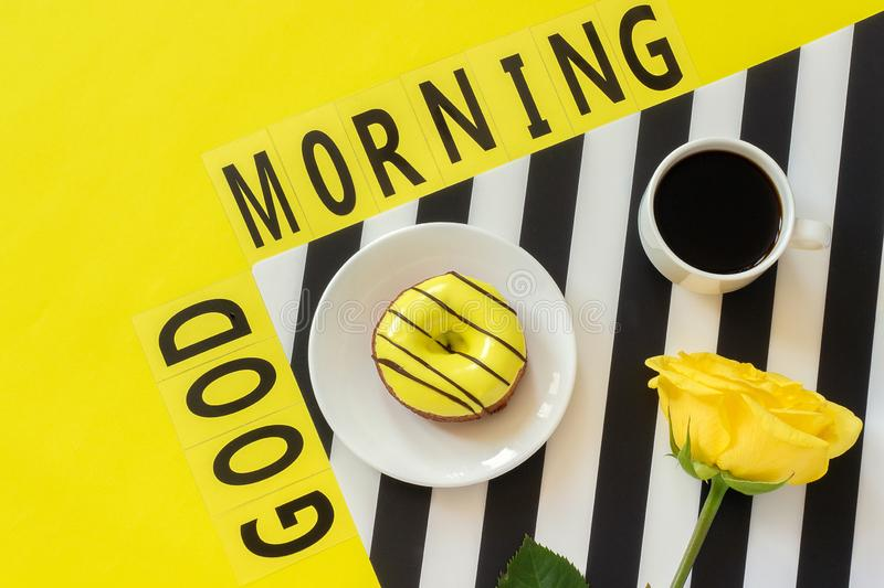 Text Good morning, coffee, notebook for text on stylish black and white napkin on yellow background. Concept good morning.  stock images