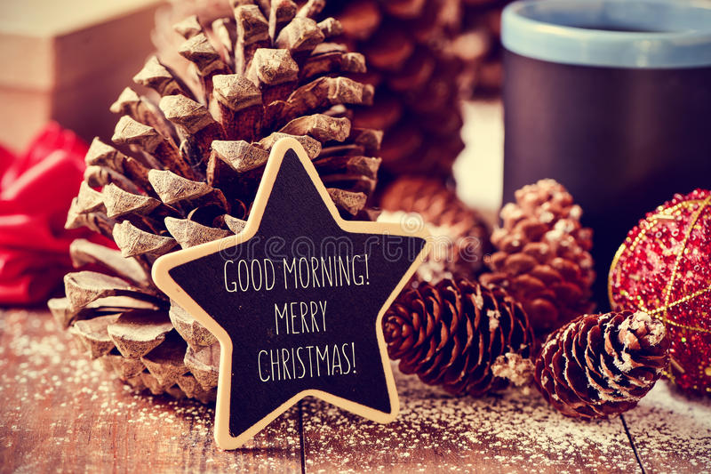 Text good morning merry christmas in a star-shaped blackboard. The text good morning merry christmas written in a star-shaped blackboard on a rustic wooden stock photo