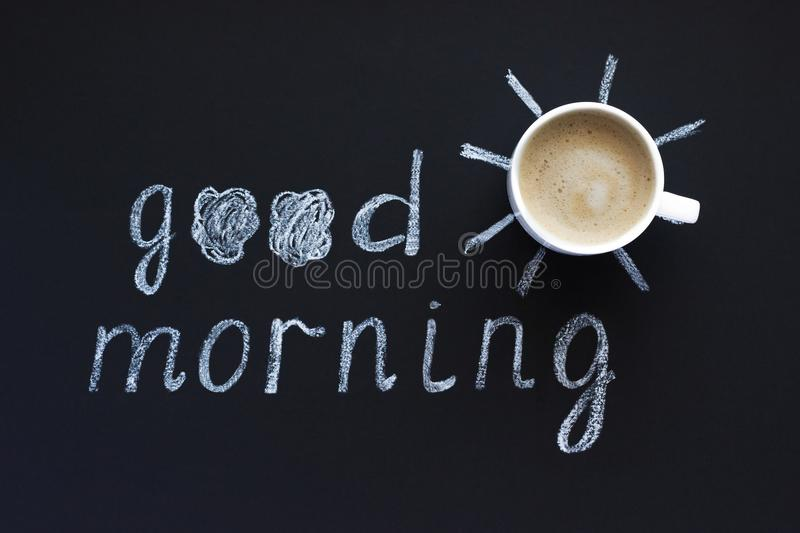 Text Good morning, sun chalk on black background, Cup of coffee, meringue. Flat Lay, Top View. Concept royalty free stock image