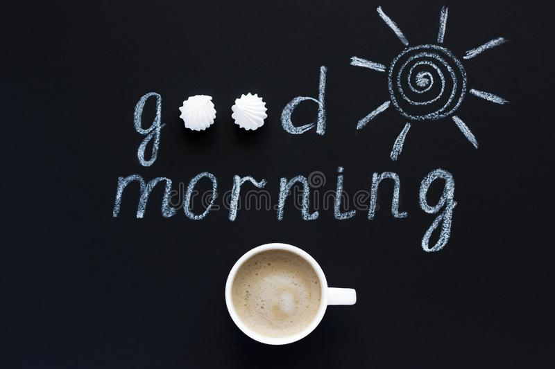 Text Good morning, sun chalk on black background, Cup of coffee, meringue. Flat Lay, Top View. Concept stock photos