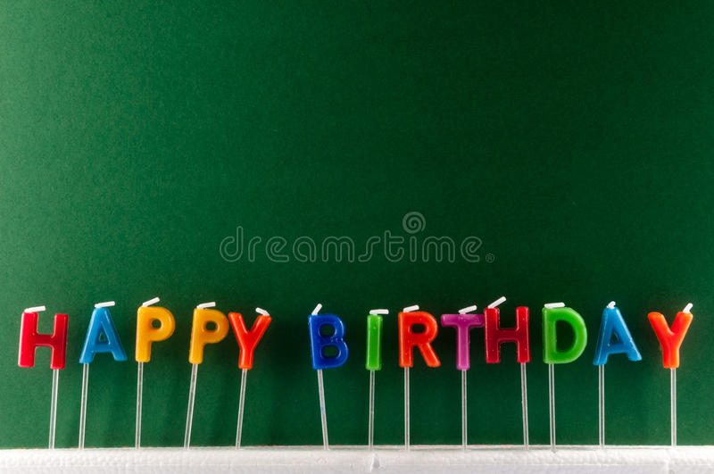 Text Happy Birthday. Many Colored Candles with Text Happy Birthday royalty free stock image