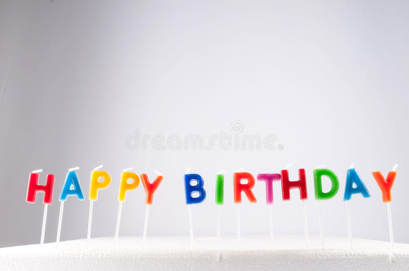Text Happy Birthday. Many Colored Candles with Text Happy Birthday royalty free stock images