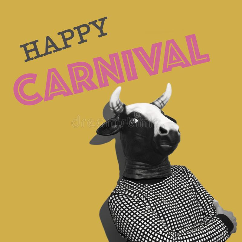 Text happy carnival in a contemporary art collage. Text happy carnival and a young caucasian man with a cow mask on an yellow background as a contemporary art stock photography
