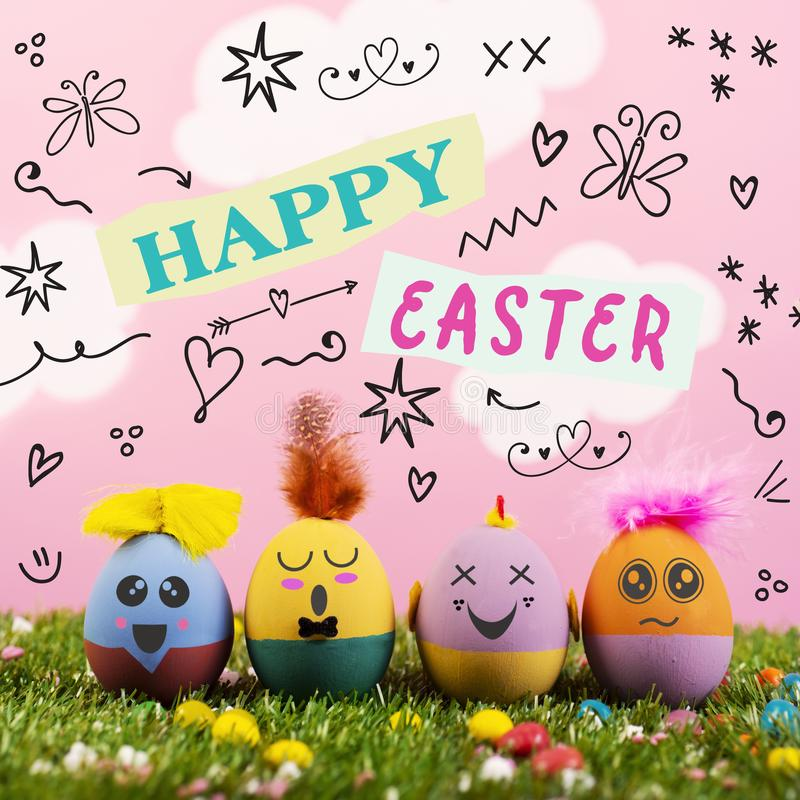 Text happy easter and cute handmade decorated eggs stock images
