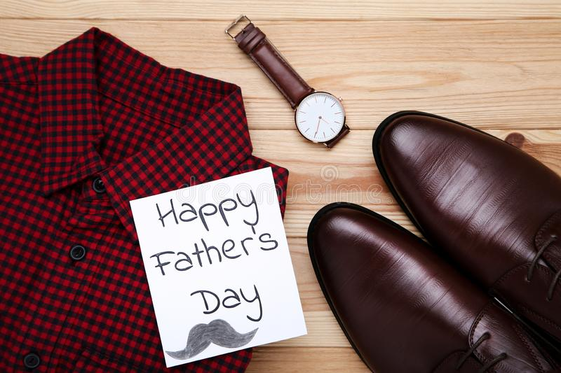 Happy Fathers Day with shirt, shoes and wrist watch royalty free stock image