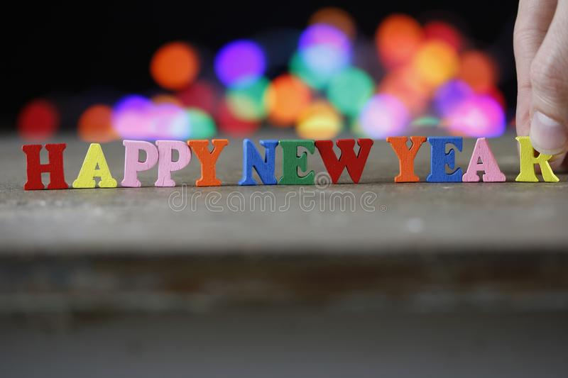 Text Happy New Year of bright multicolored wooden letters. Close-up royalty free stock photos