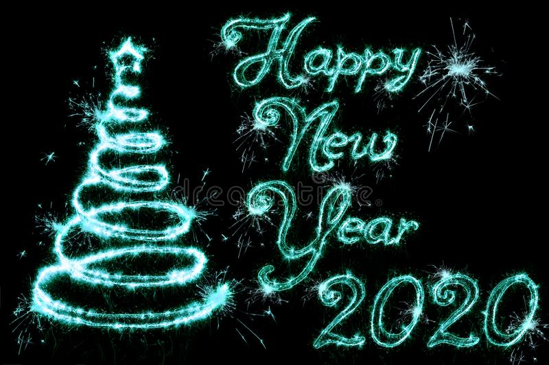 Text Happy New Year 2020 with christmas tree written sparkling sparklers fireworks isolated on black background. Overlay template stock photography