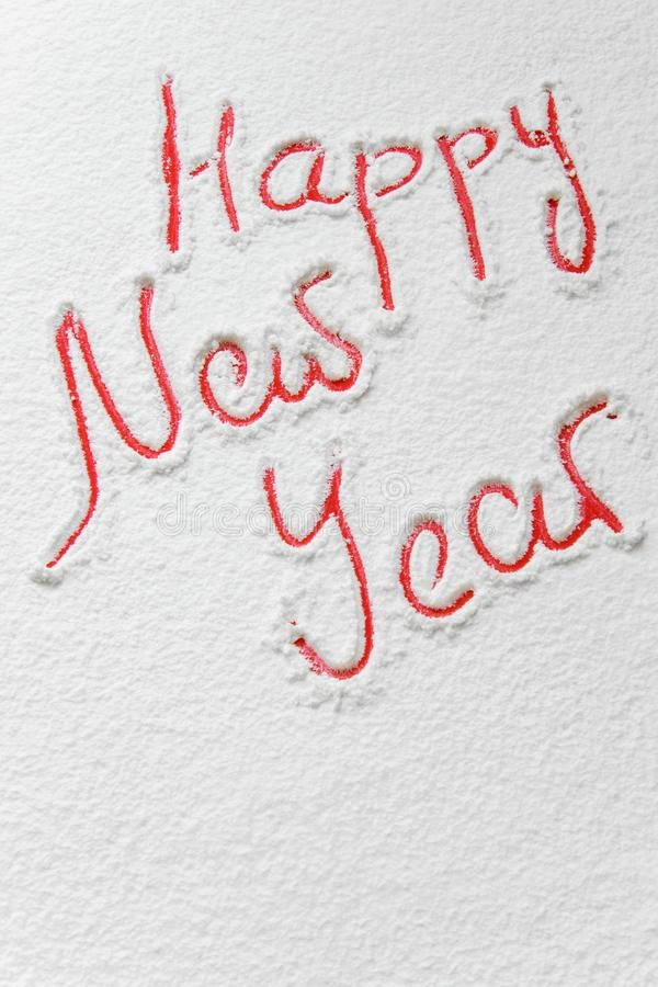 Text `Happy New Year` on the snow. Copy space stock photography