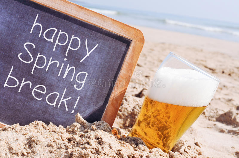 Text happy spring break in a chalkboard stock images