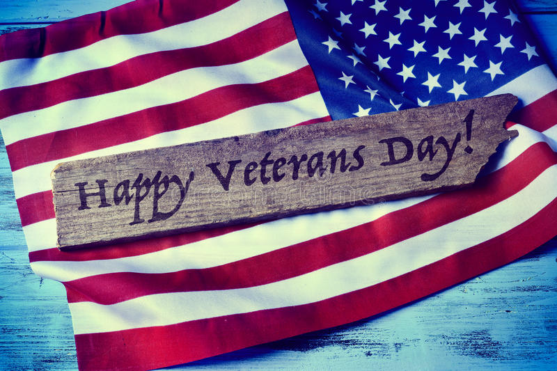 Text happy veterans day and the flag of the US stock photography