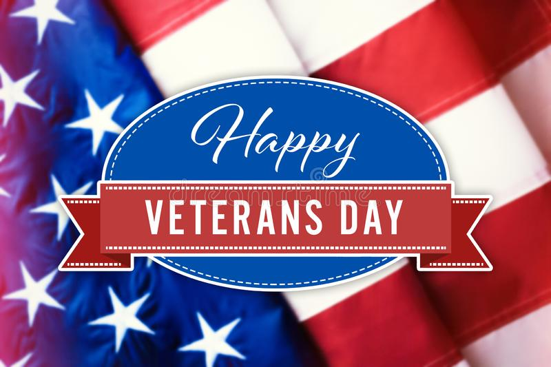 Text HAPPY VETERANS DAY and USA flag royalty free stock photo