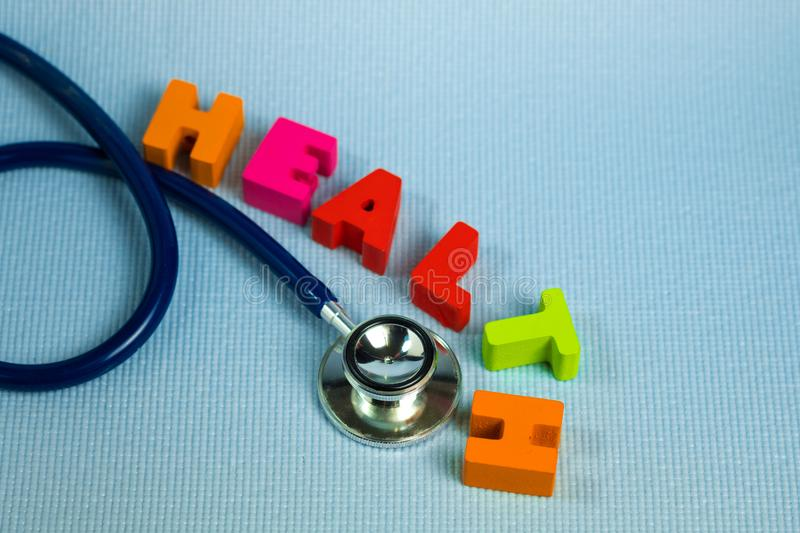 Text healthy alphabet with stethoscope, healthy and health care royalty free stock image