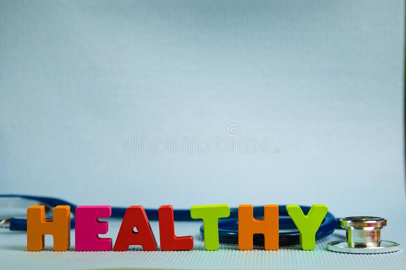 Text healthy alphabet with stethoscope, healthy and health care. Concept idea stock photos