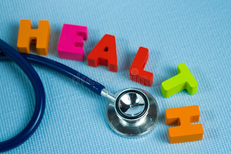 Text healthy alphabet with stethoscope, healthy and health care. Concept idea royalty free stock image