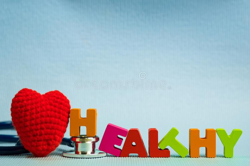 Text healthy alphabet with stethoscope, healthy and health care. Concept idea royalty free stock photography
