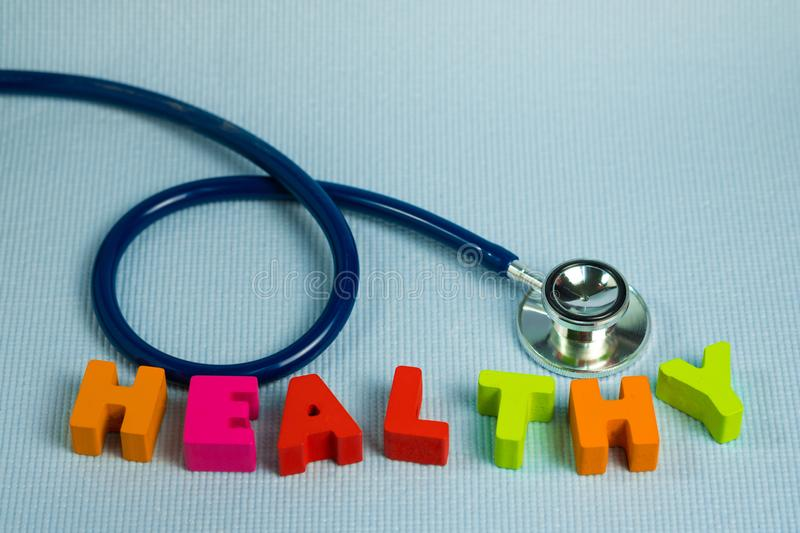 Text healthy alphabet with stethoscope, healthy and health care. Concept idea stock images