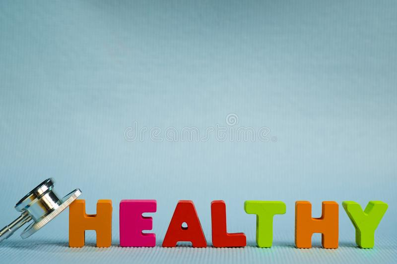 Text healthy alphabet with stethoscope, healthy and health care. Concept idea stock photography