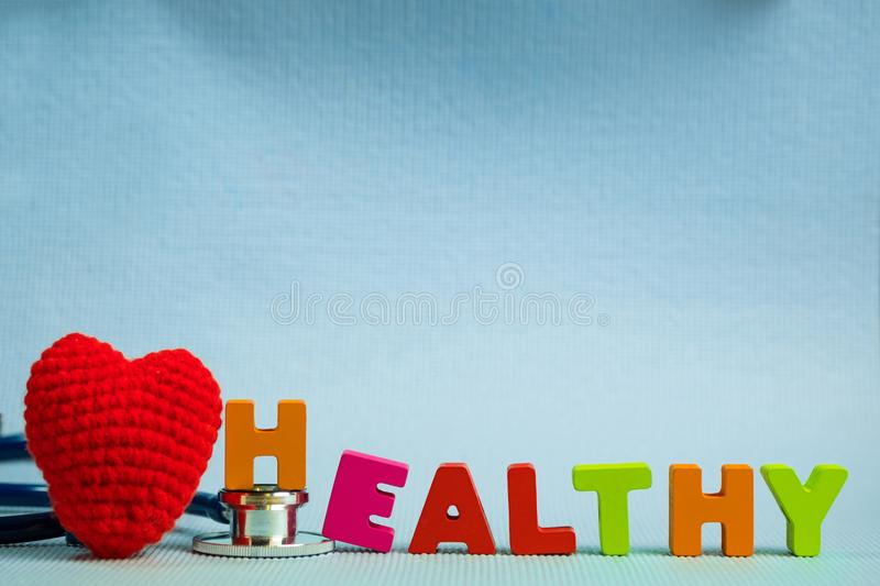 Text healthy alphabet with stethoscope, healthy and health care royalty free stock photography
