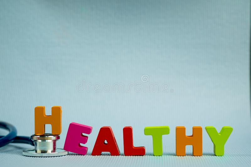 Text healthy alphabet with stethoscope, healthy and health care royalty free stock photo