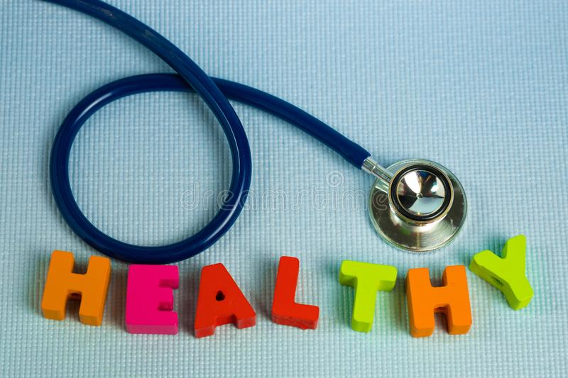 Text healthy alphabet with stethoscope, healthy and health care royalty free stock photos