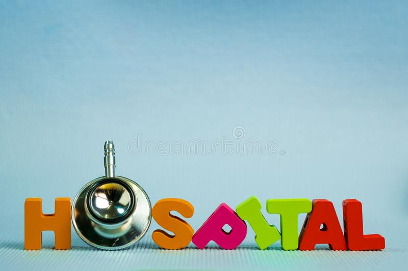 Text hospital alphabet with stethoscope, healthy and health care stock photo